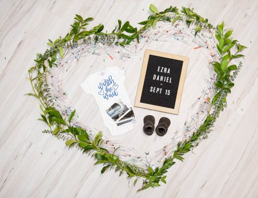 ivf pregnancy announcement with worth the wait onesie, ultrasound, baby shoes and letterboard with babies name and due date